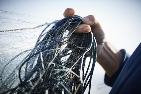 Netze in der Hand